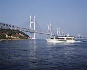 Seto Ohashi bridge and a pleasure boat,  Kagawa Prefecture,  Japan