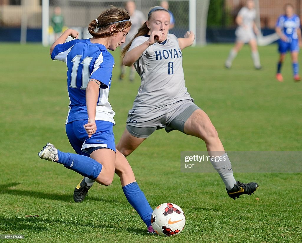 Seton Hall midfielder Amie Ruhe (11) clears the ball against Georgetown forward Audra Ayotte (8) during first-half action at Shaw Field on the Georgetown campus in Washington, D.C., Saturday, November 2, 2013. Georgetown defeated Seton Hall, 2-0.