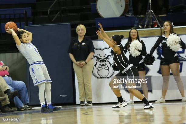 Seton Hall Pirates guard Kaela Hilaire falls backwards during a Big East Tournament game between Providence Lady Friars and the Seton Hall Pirates on...