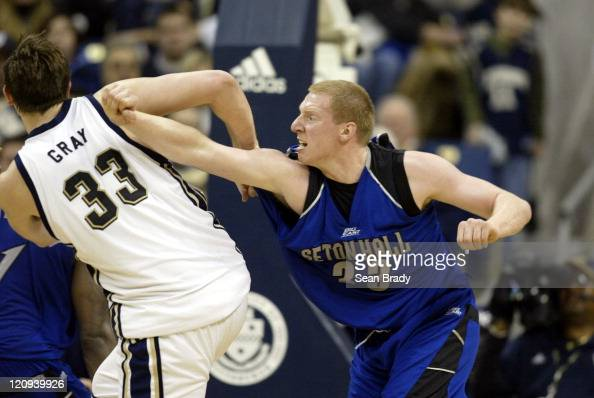 Seton Hall's Grant Billmeier battles with Pittsburgh's Aaron Gray for position during action at the Petersen Events Center on March 3 2006 in...