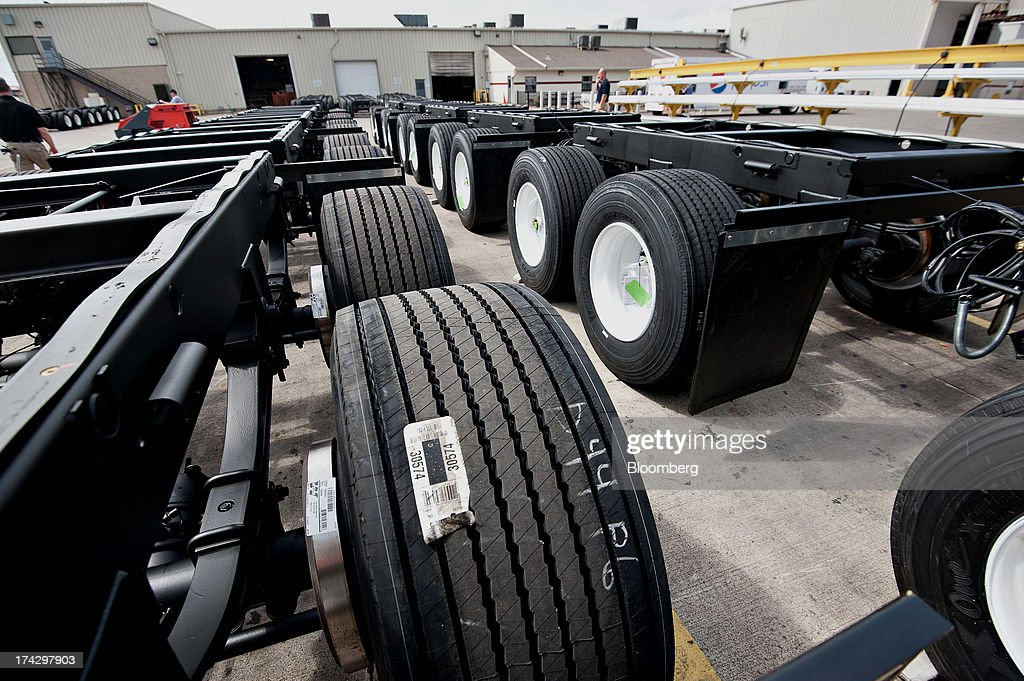 Sets of 'super single' rear wheels for semi trailers, called bogies, sit outside at the Wabash National Corp. facility in Lafayette, Indiana, U.S., on Monday, July 22, 2013. Wabash National Corp. is scheduled to release earnings figures on July 30. Photographer: Daniel Acker/Bloomberg via Getty Images