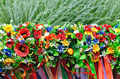 sets of Ukrainian traditional wreaths against the leaves background