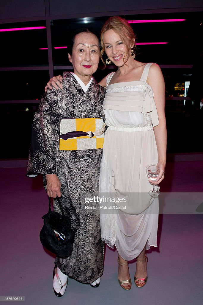 Setsuko de Rola and kylie Minogue attend the Auction Dinner to Benefit 'Institiut Imagine' on September 10, 2015 in Paris, France.