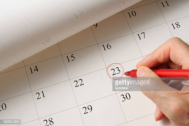 Setting a date on calendar by red pen