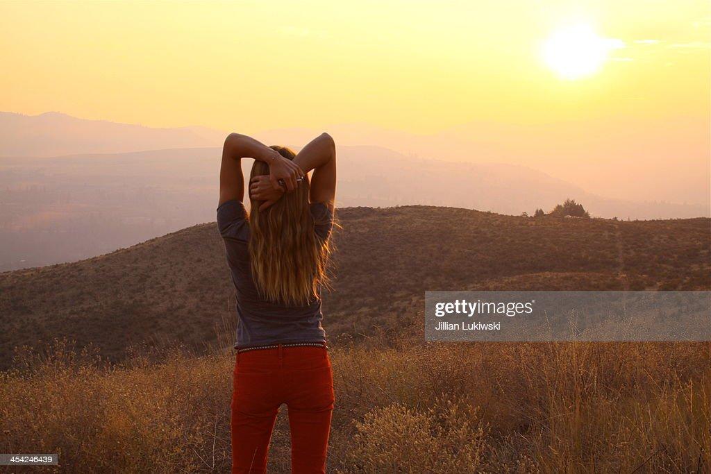 Setting Sun and Woman : Stock Photo