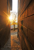 Setting sun between old house facades