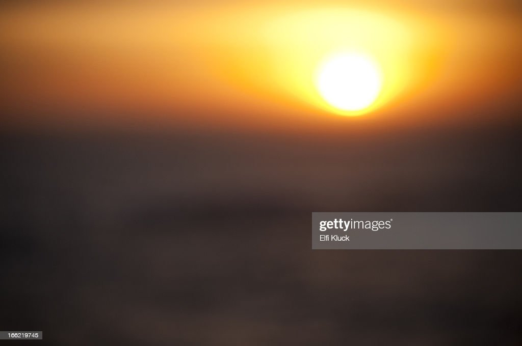 Setting sun glowing in the sky : Stock Photo