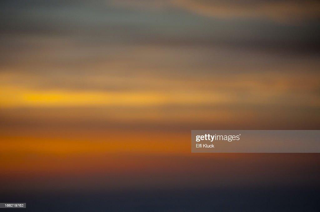 Setting sun illuminating the sky : Stock Photo