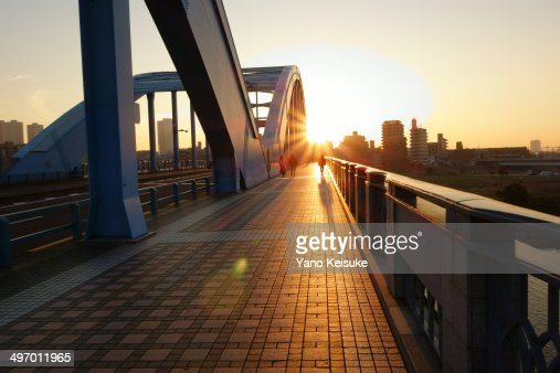 Setting sun on a bridge