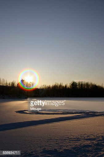 Setting wintery sun in Finland : Stock Photo