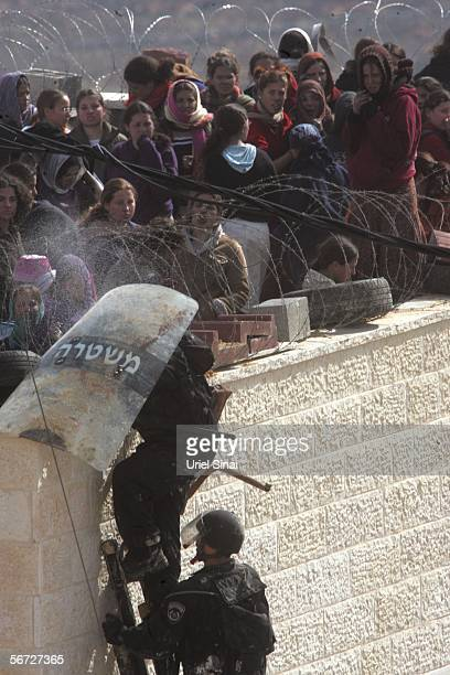 A settler injured during clashes with riot police is seen February 1 2006 in the West Bank outpost of Amona The eighty residents of Amona compose one...