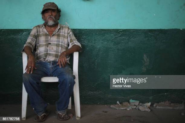 A settler of Jojutla who survived the fall of the building where he worked as caretaker poses for pictures three days after the magnitude 71...