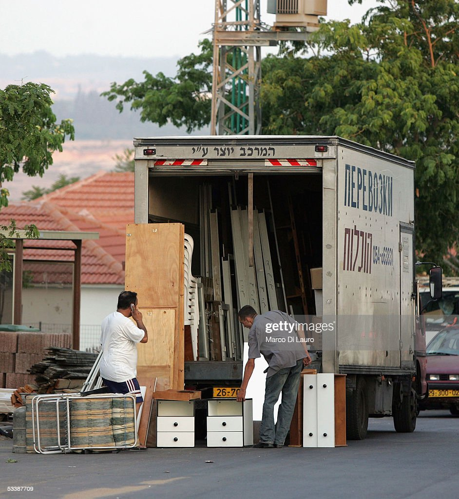Settlers pack their belongings into a truck on August 14 2005 in Nisanit Gaza Strip Gaza settlers received formal letters from the military telling...