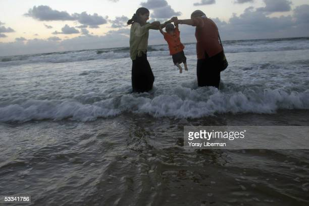 Settlers play inthe water on August 8 2005 in Shirat Hayam Gaza Strip Hundreds of antidisengagement Israelis from all over the country and the West...