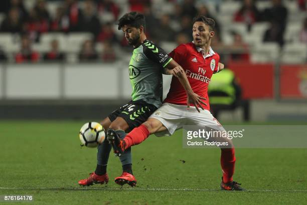 Setubal's forward Joao Amaral from Portugal vies with Benfica's defender Alejandro Grimaldo from Spain for the ball possession during the match...