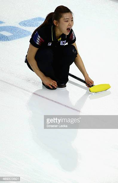 Seulbee Lee of Korea competes against China during the Women's Curling Round Robin match on day seven of the Sochi 2014 Winter Olympics at Ice Cube...