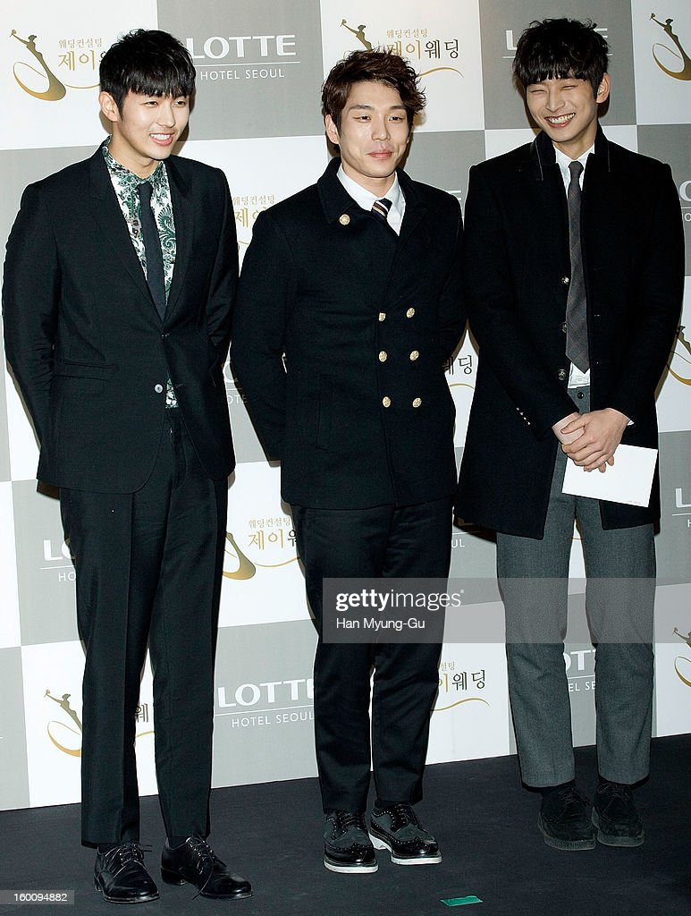 Seulong, Changmin and Jinwoon of South Korean boy band 2AM attend the wedding of Sun of Wonder Girls at Lotte Hotel on January 26, 2013 in Seoul, South Korea.