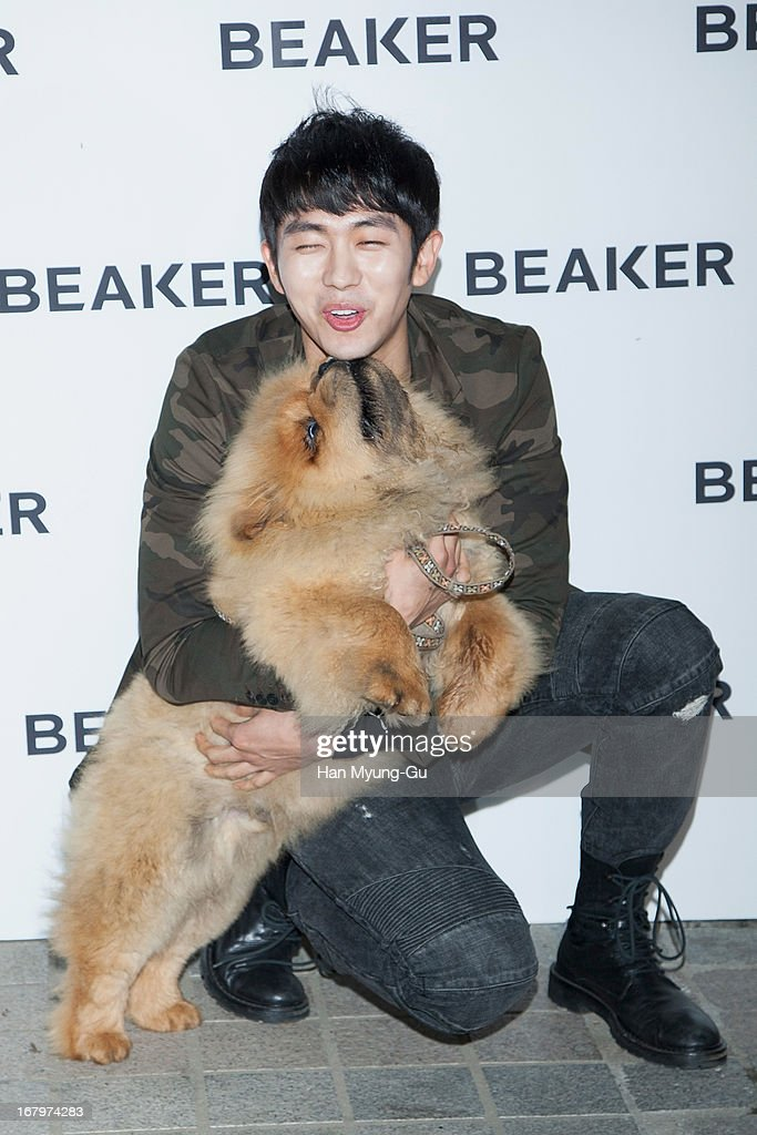 Seulong of South Korean boy band 2AM and his pet attend a promotional event for the 'BEAKER' Gangnam Flagship Store Opening on May 3, 2013 in Seoul, South Korea.