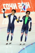 Seung Hoon Lee and Hyong Jun Joo of South Korea celebrate winning the silver medal during the Men's Team Pursuit Final A Speed Skating event on day...