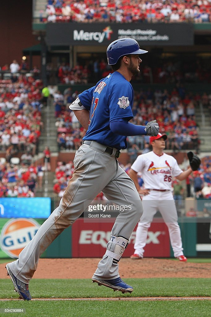 Seung Hwan Oh #26 of the St. Louis Cardinals calls for a new ball as Kris Bryant #17 of the Chicago Cubs runs the bases after hitting a three-run home run during the sixth inning at Busch Stadium on May 25, 2016 in St. Louis, Missouri.