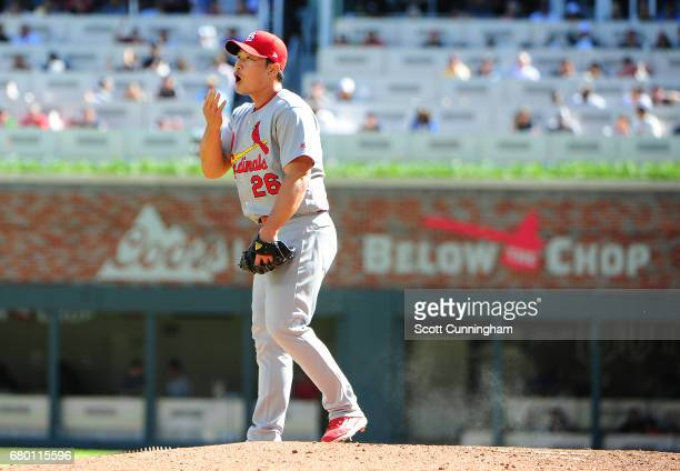 Seung Hwan Oh of the St Louis Cardinals gets set to throw in the 11th inning against the Atlanta Braves at SunTrust Park on May 7 2017 in Atlanta...