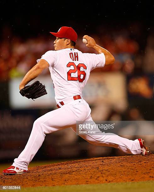 Seung Hwan Oh of the St Louis Cardinals pitches against the Milwaukee Brewers during the ninth inning of a baseball game at Busch Stadium on...