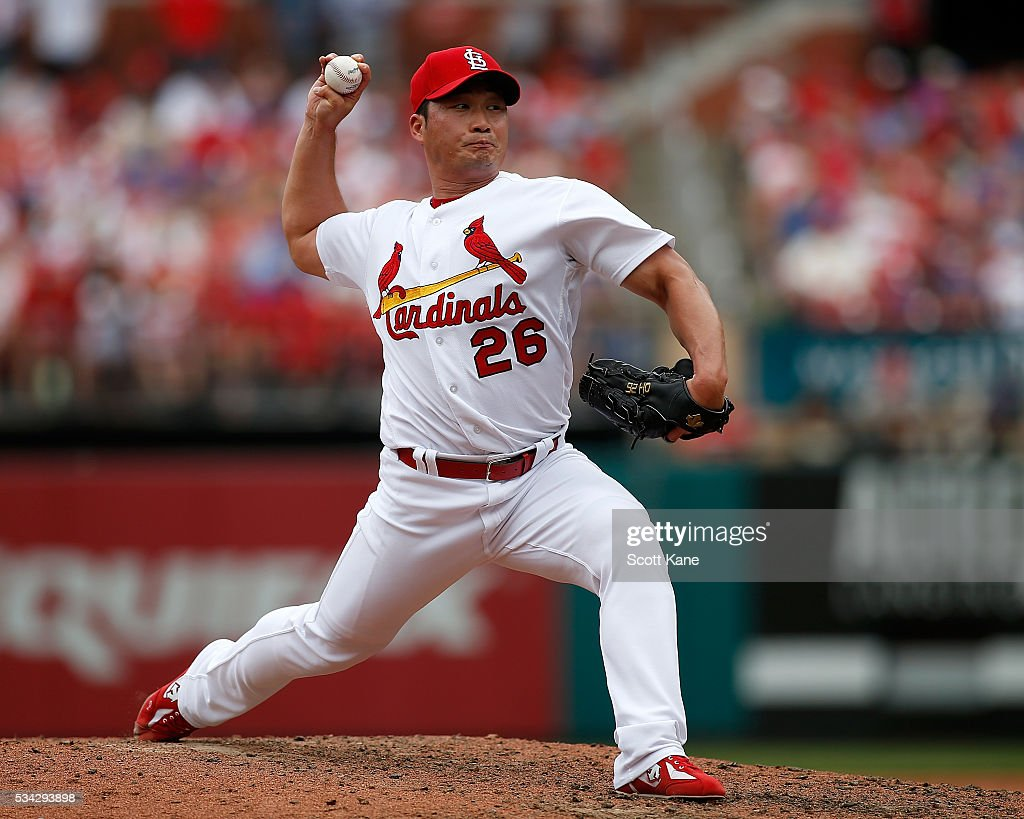 Seung Hwan Oh #26 of the St. Louis Cardinals pitches during the sixth inning of a baseball game against the Chicago Cubs at Busch Stadium on May 25, 2016 in St. Louis, Missouri.