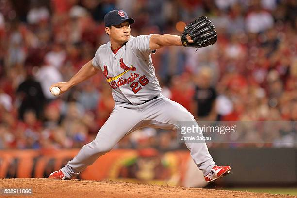 Seung Hwan Oh of the St Louis Cardinals pitches in the seventh inning against the Cincinnati Reds at Great American Ball Park on June 8 2016 in...