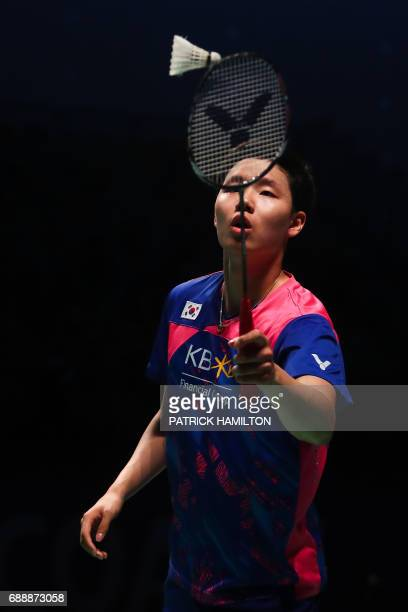Seung Jae Seo of South Korea hits a return during the men's doubles Sudirman Cup match with partner Choi Solgyu against Bodin Issara and Dechapol...