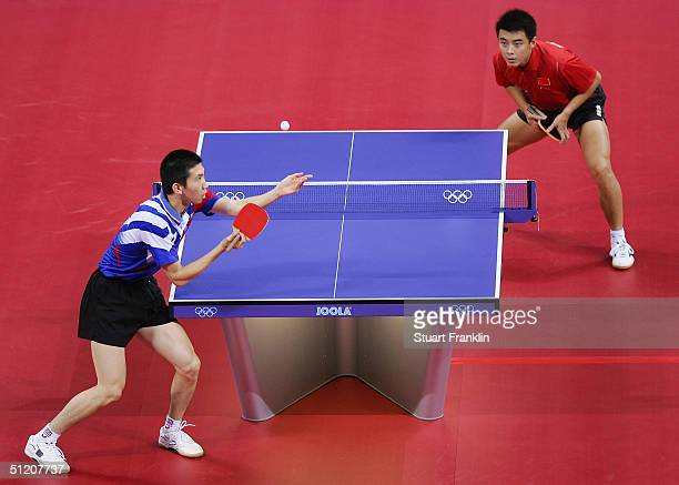 Seung Min Ryu of Korea in action with Hao Wang of China during the men's singles table tennis gold medal match on August 23 2004 during the Athens...