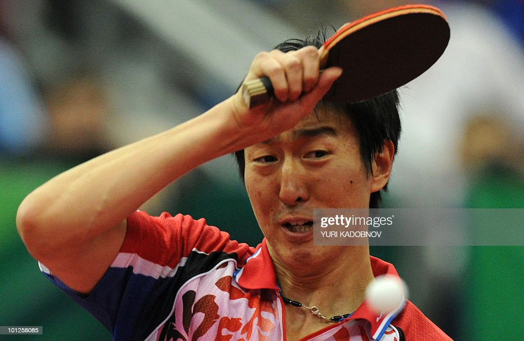 Seung Min Ryu of Korea returnes a serve to Dimitrij Ovtcharov of Germany during the men's semi final at the 2010 World Team Table Tennis Championships in Moscow on May 29, 2010.