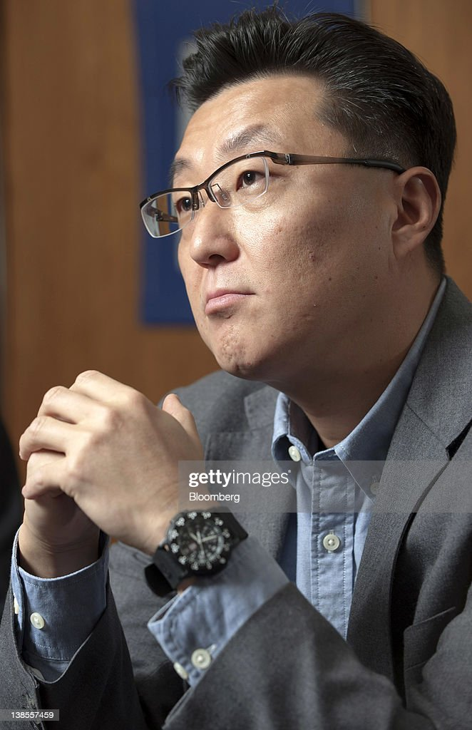 Seung Woo Choi, president of Nexon Co., listens during an interview in Tokyo, Japan, on Wednesday, Feb. 8, 2012. Nexon Co. is an online game creator that's more profitable than Zynga Inc. Photographer: Akio Kon/Bloomberg via Getty Images