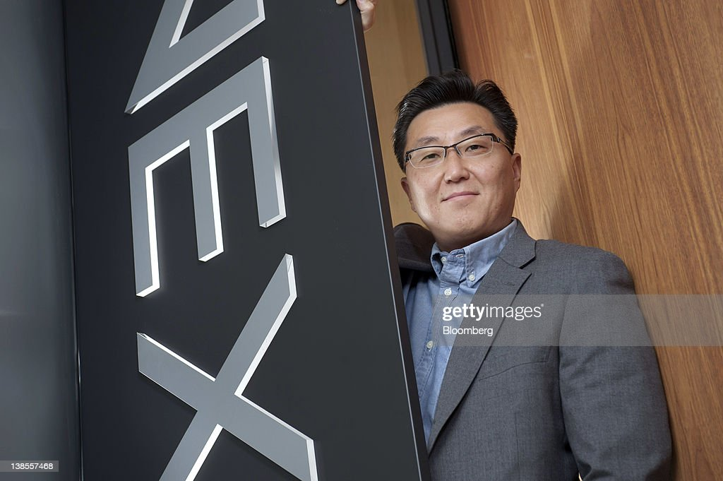 Seung Woo Choi, president of Nexon Co., poses for a photograph in Tokyo, Japan, on Wednesday, Feb. 8, 2012. Nexon Co. is an online game creator that's more profitable than Zynga Inc. Photographer: Akio Kon/Bloomberg via Getty Images