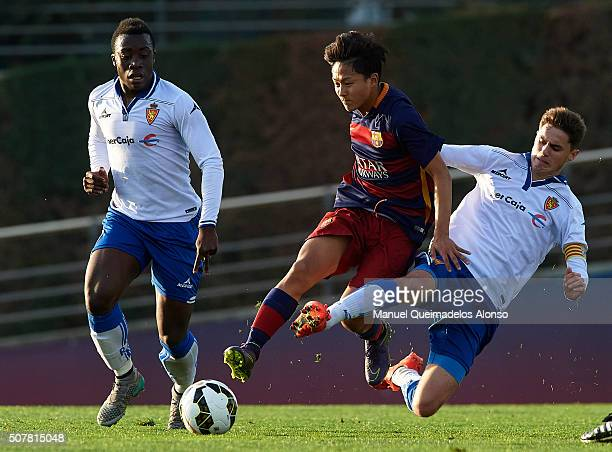 Seung Woo Lee of Barcelona is tackled by Pablo Roldan of Zaragoza during the match between FC Barcelona U18 and Real Zaragoza U18 at Ciutat Esportiva...