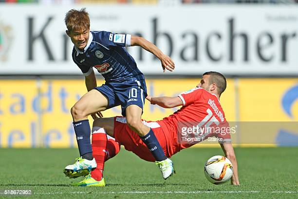 Seung Woo Ryu of and Lukas Schmitz of Duesseldorf fight for the ball during the Second Bundesliga match between Arminia Bielefeld and Fortuna...