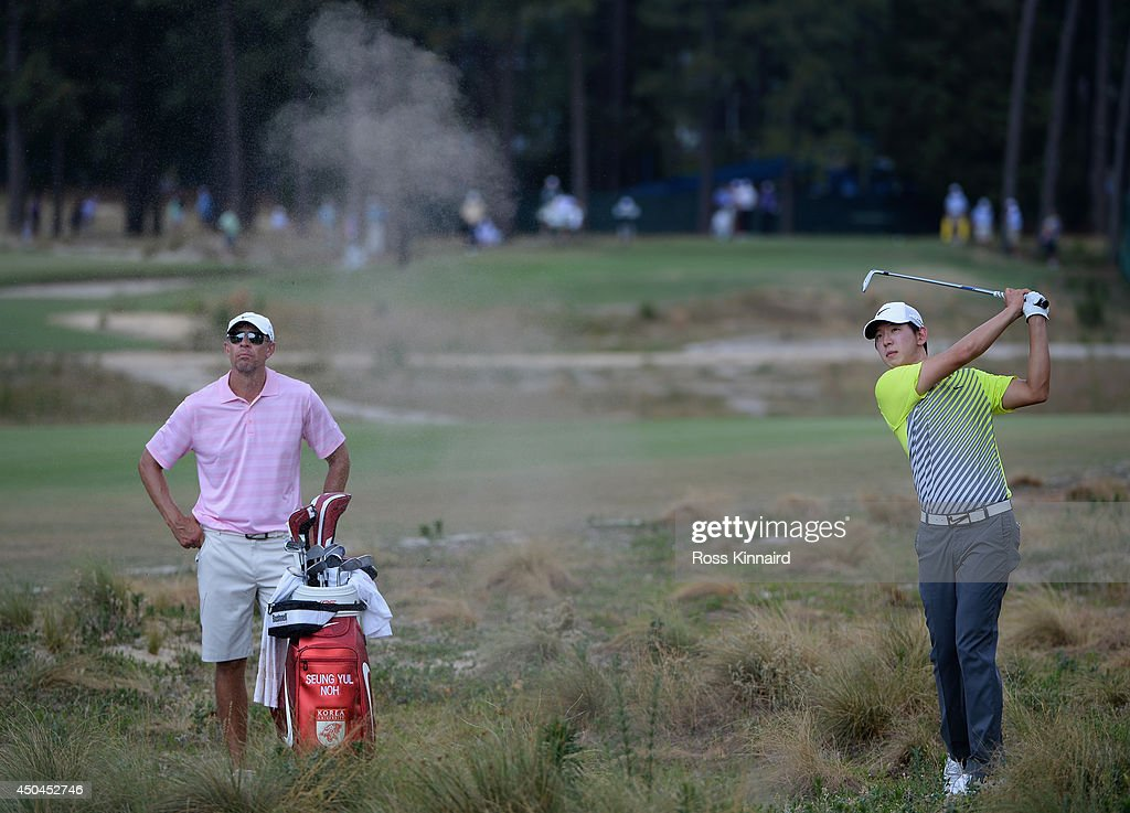 Seung Yul Noh of Korea with his caddie during a practice round prior to the start of the 114th U.S. Open at Pinehurst Resort & Country Club, Course No. 2 on June 11, 2014 in Pinehurst, North Carolina.
