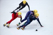 SeungHi Park of South Korea leads the pack in the Short Track Women's 1000m Final A on day fourteen of the 2014 Sochi Winter Olympics at Iceberg...