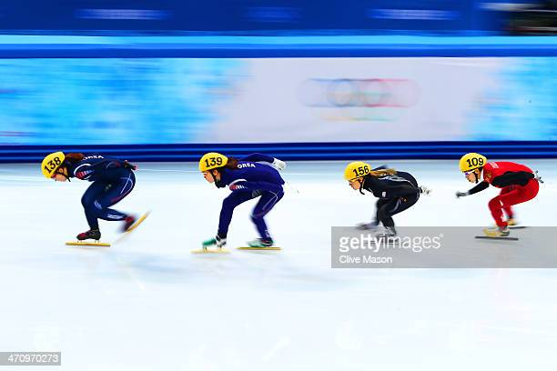 SeungHi Park of South Korea Suk Hee Shim of South Korea Jessica Smith of the United States Kexin Fan of China compete in the Short Track Women's...