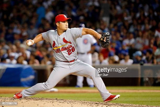 SeungHwan Oh of the St Louis Cardinals pitches against the Chicago Cubs during the seventh inning at Wrigley Field on July 23 2017 in Chicago...