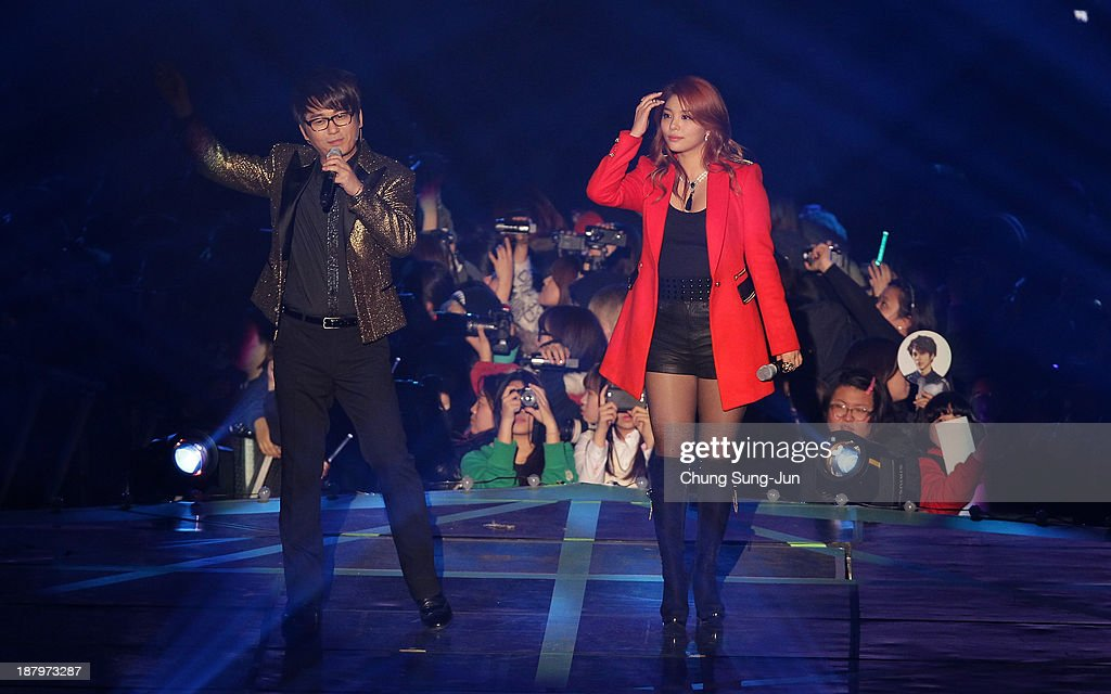 Seung-Jun and Ailee perform onstage during the MelOn Music Awards at Olympic Gymnasium on November 14, 2013 in Seoul, South Korea.