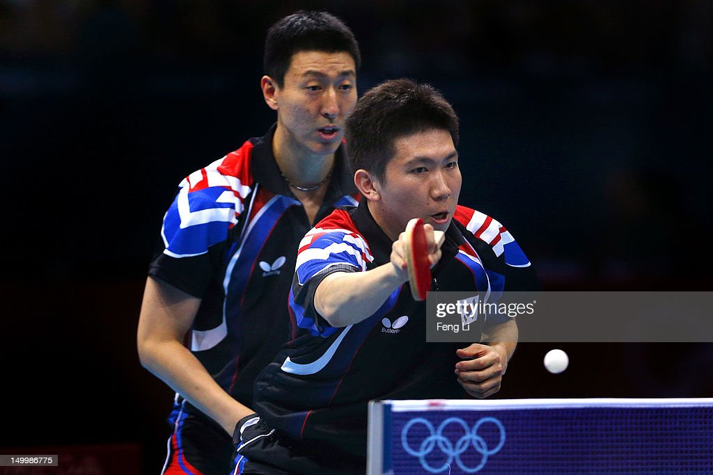 Seungmin Ryu (R) and Sang Eun Oh (L) of Korea compete against Zhang Jike and Wang Hao of China during the Men's Team Table Tennis gold medal match on Day 12 of the London 2012 Olympic Games at ExCeL on August 8, 2012 in London, England.