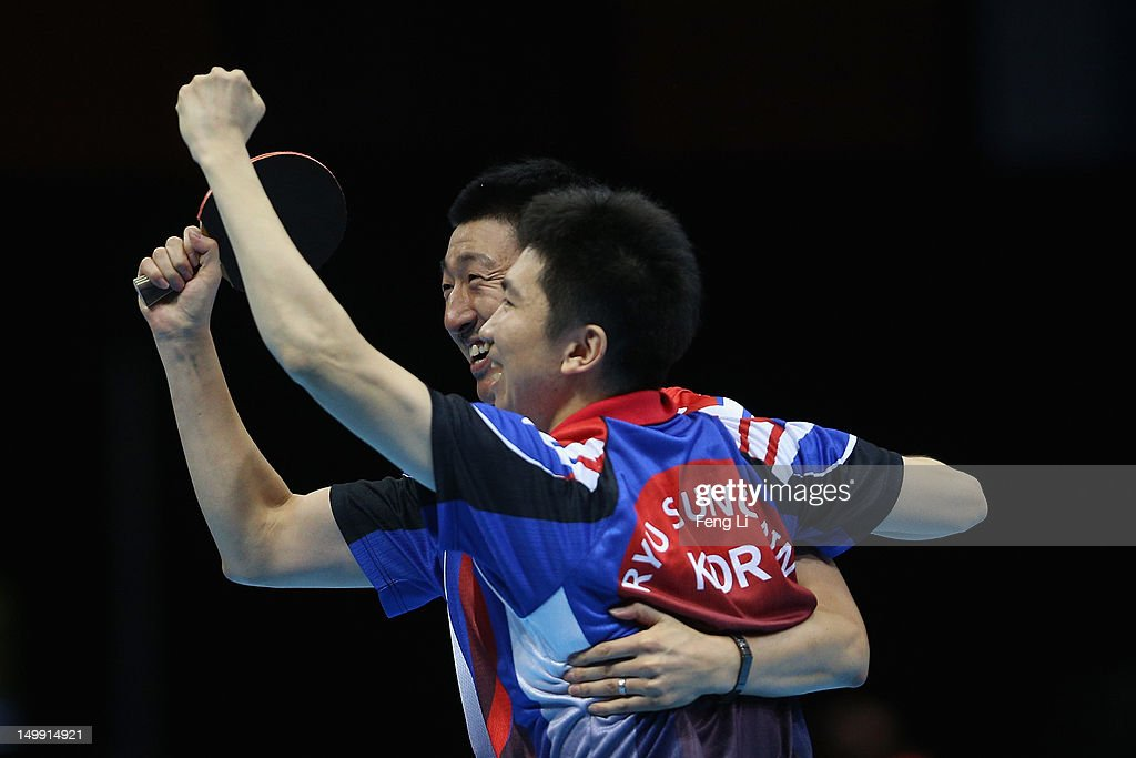Seungmin Ryu and Sangeun Oh of Korea celebrate after winning Men's Team Table Tennis semifinal match against team of Hong Kong, China on Day 10 of the London 2012 Olympic Games at ExCeL on August 6, 2012 in London, England.