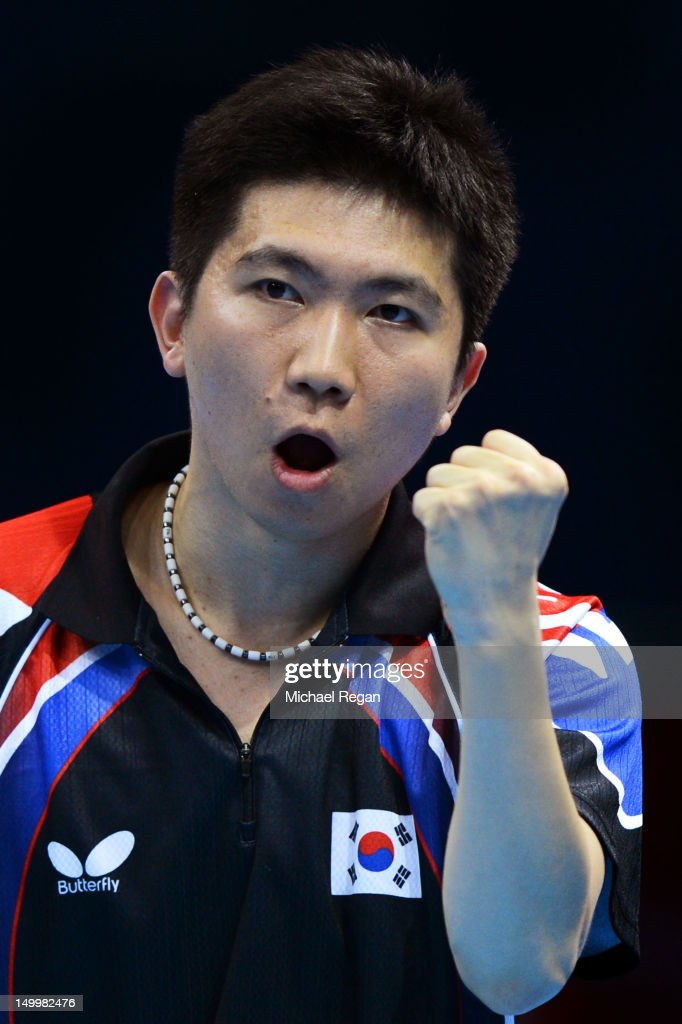 Seungmin Ryu of Korea reacts while competing against Ma Long of China during the Men's Team Table Tennis gold medal match on Day 12 of the London 2012 Olympic Games at ExCeL on August 8, 2012 in London, England.