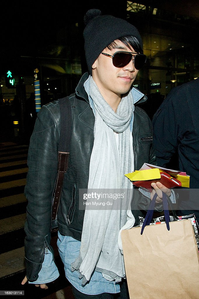 <a gi-track='captionPersonalityLinkClicked' href=/galleries/search?phrase=Seungri&family=editorial&specificpeople=8201741 ng-click='$event.stopPropagation()'>Seungri</a> of South Korean boy band Bigbang is seen upon arrival from China at Incheon International Airport on March 3, 2013 in Incheon, South Korea.
