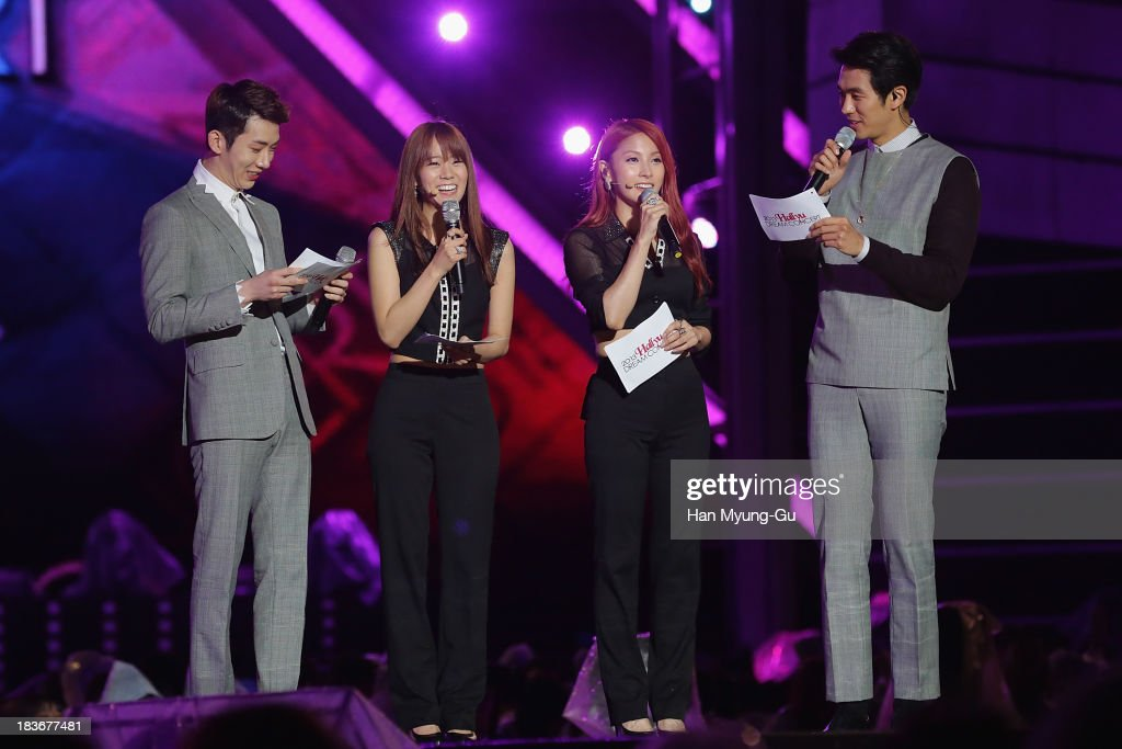 Seungyeon Gyuri of South Korean girl group Kara and Jo Kwon Seulong of South Korean boy band 2AM attend the 2013 Hallyu Dream Concert on October 5...
