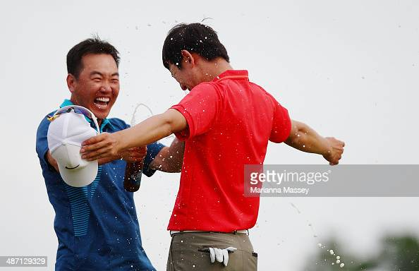 SeungYul Noh has beer poured on him by golfer Charlie Wi after winning the Zurich classic during the final round of the Zurich Classic of New Orleans...