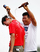 SeungYul Noh has beer poured on him by golfer YE Yang after winning the Zurich classic during the final round of the Zurich Classic of New Orleans at...