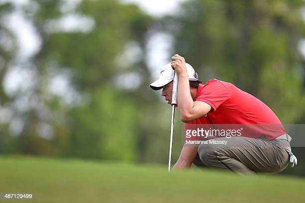SeungYul Noh lines up his putt on the 18th green during the final round of the Zurich Classic of New Orleans at TPC Louisiana on April 27 2014 in...