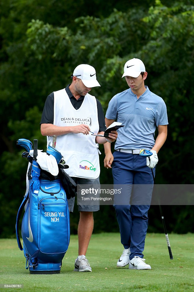 Seung-Yul Noh of Korea is seen with his caddie on the sixth tee during the First Round of the DEAN & DELUCA Invitational at Colonial Country Club on May 26, 2016 in Fort Worth, Texas.