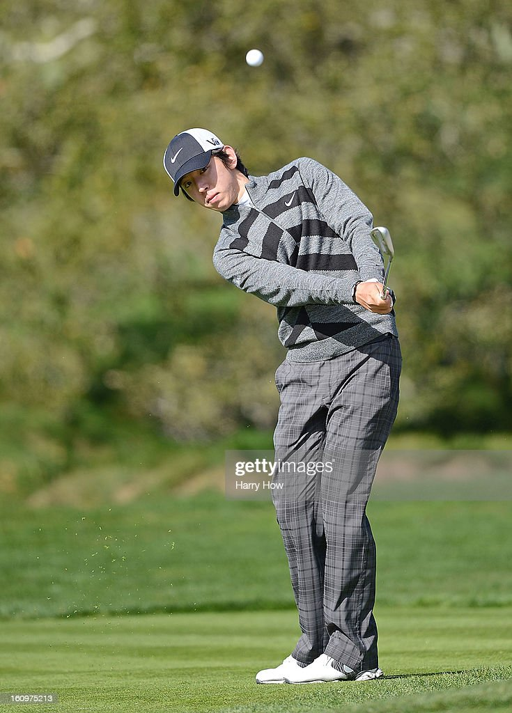 Seung-Yul Noh of South Korea hits a pitch shot on the second hole during the second round of the AT&T Pebble Beach National Pro-Am at Pebble Beach Golf Links on February 8, 2013 in Pebble Beach, California.